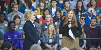 Sophie Meads (19)introduces Hillary Clinton to the stage in front of College Hall  Source: Mehrdad Zarifka
