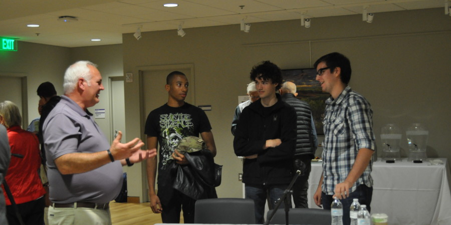 Paul Tuerler talks to Dale Dellimore (19), Ryan Kelly (18), and Micah Hawker-Boehnke (16) after the forum